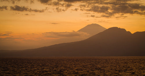 sunset behind the volcano of Bali